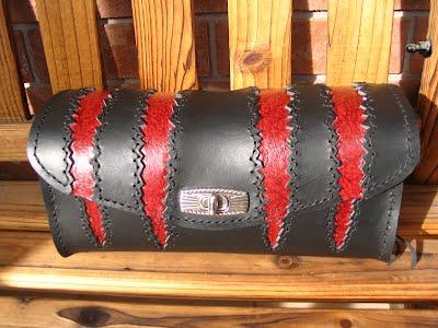 http://www.taurusseats.com/_/rsrc/1321205394331/accessories/toolbags/cmtb/clawmark2.JPG?height=300&width=400&height=240&width=320