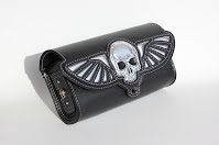https://sites.google.com/a/taurusseats.com/site/accessories/toolbags/flyingskull/Flying_skull_toolbag_2.jpg?attredirects=0