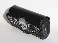https://sites.google.com/a/taurusseats.com/site/accessories/toolbags/flyingskull/Flying_skull_toolbag_3.jpg?attredirects=0