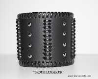 http://www.etsy.com/ca/listing/164794301/black-leather-cuff-wristband-motorcycle