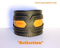 http://www.etsy.com/ca/listing/188487803/black-orange-leather-cuff-bracelet